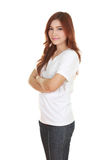 Woman with arms crossed, wearing white t-shirt Royalty Free Stock Photos