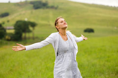 Woman arms open grassland Royalty Free Stock Photos