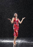 Woman With Arms Out Enjoying The Rain stock photo