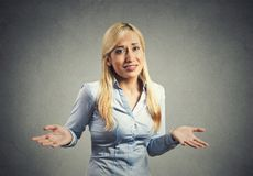 Woman arms out shrugs shoulders Royalty Free Stock Images