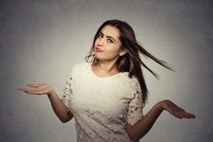 Woman arms out shrugs shoulders who cares so what royalty free stock photos