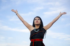 Woman with arms out towards sky Stock Images