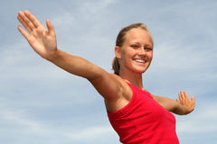 Woman with arms outstretched Stock Image