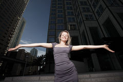 Woman with arms outstretched. Attractive young woman with her arms outstretched Stock Images