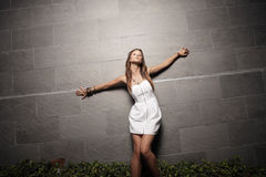 Woman with arms outstretched Royalty Free Stock Photos