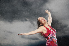 Woman With Arms Outstretched Enjoying The Rain Stock Photography