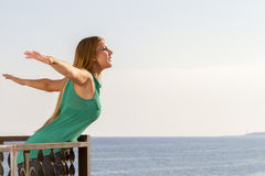 Woman with arms outstretched Royalty Free Stock Images