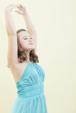 Woman with arms posed above her head Stock Images