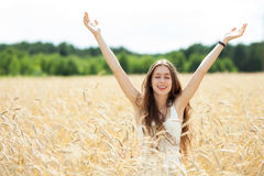Woman with arms raised Stock Photo