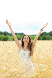 Woman with arms raised Royalty Free Stock Image