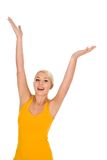 Woman with arms raised stock image