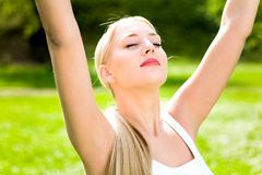 Woman with arms raised stock photography