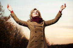 Happy fashion woman with arms raised outdoor. Happy blond fashion woman with arms raised outdoor Stock Photography