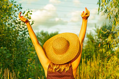 Woman arms raised enjoying the fresh air in green forest Royalty Free Stock Image