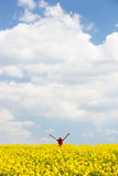 Woman with arms raised high, enjoying freedom Stock Photo