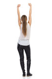 Woman With Arms Raised Rear View Royalty Free Stock Photography