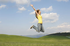 Woman With Arms Raised Screaming While Jumping In Park Royalty Free Stock Photo