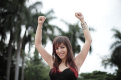 Woman with arms up. Young woman with her arms outstretched upward Royalty Free Stock Photo