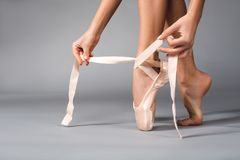 Woman arms wearing ballet shoes royalty free stock photos