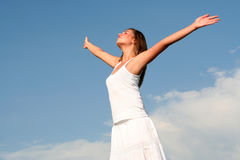 Woman with arms wide open Royalty Free Stock Photos