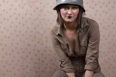 Woman in army hat and a  creative makeup Stock Photography
