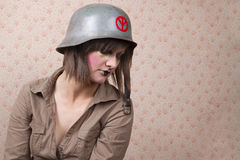 Woman in army hat and a  creative makeup Stock Image