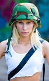 Woman with army helmet Royalty Free Stock Image