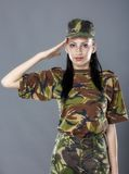 Woman army soldier saluting. Isolated on gray background Royalty Free Stock Images