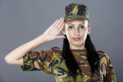 Woman army soldier saluting. Isolated on gray background Royalty Free Stock Photos