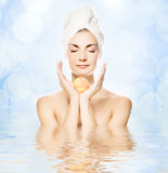 Woman with aroma bath ball royalty free stock photos