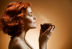 Woman with an aromatic coffee in hands Royalty Free Stock Photos