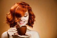 Woman with an aromatic coffee in hands royalty free stock photography