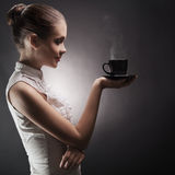 Woman with an aromatic coffee in hands Stock Photos