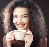 Woman with an aromatic coffee Stock Image