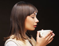 Woman with an aromatic coffee Stock Photos