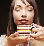 Woman with an aromatic coffee Stock Photography