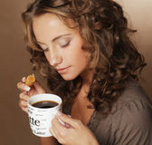 Woman with an aromatic coffee in hands Royalty Free Stock Images