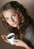 Woman with an aromatic coffee in hands Royalty Free Stock Photo