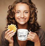 woman with an aromatic coffee in hands Stock Photography