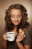 Woman with an aromatic coffee in hands Stock Images