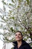 Woman around white blossoms Stock Photos
