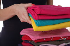 Woman arrange laundry Stock Photography