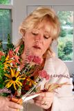 Woman arranging fall flowers Stock Photos