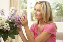 Woman Arranging Flowers Stock Photo