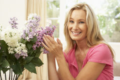 Woman Arranging Flowers Stock Images