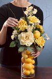 Woman arranging flowers Royalty Free Stock Photos