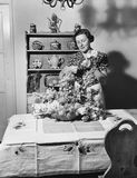 Woman arranging flowers at home Stock Images