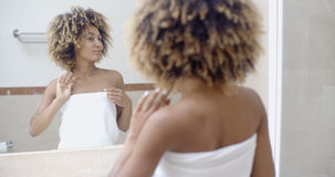 Woman Arranging Her Exotic Curly Hair Royalty Free Stock Images