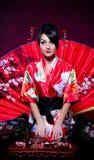 Woman arranging Japanese tea ceremony Stock Photo