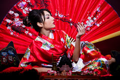 Woman arranging Japanese tea ceremony Royalty Free Stock Photos